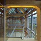 Impressive woodwork in this Swiss commercial project by the Japanese design firm; Shigeru Ban Architects